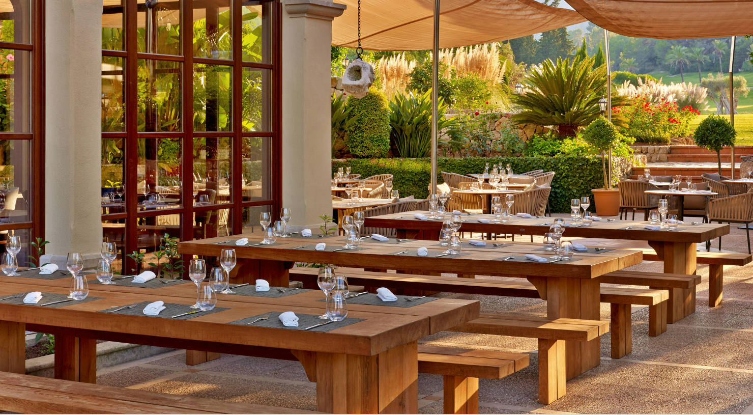 Enjoy a refreshing drink or authentic Majorcan food overlooking the son vida golf course